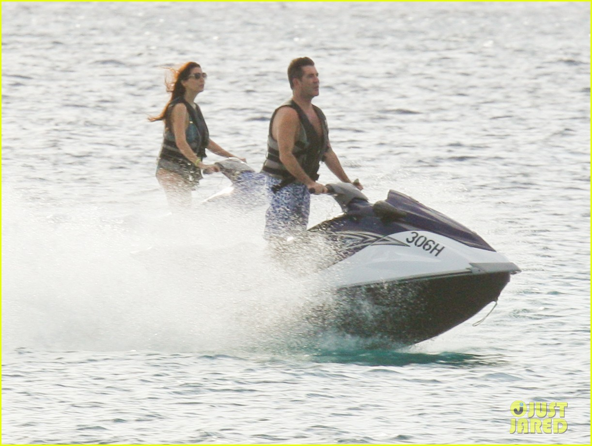 simon cowell jet skiing with former fiancee mezhgan hussainy 072781529