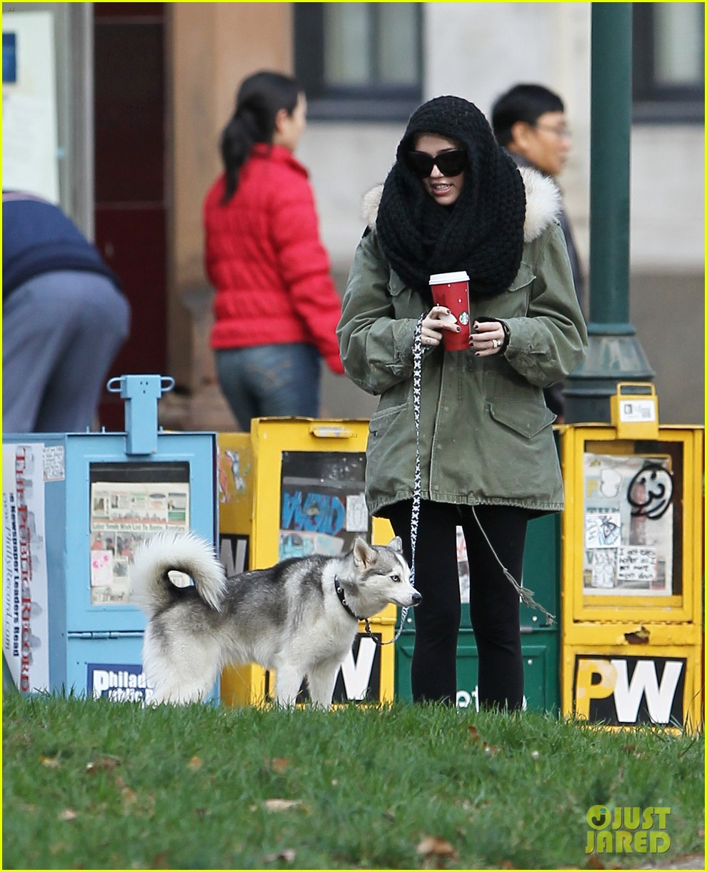 miley cyrus bundles up for philly dog walk 072777935