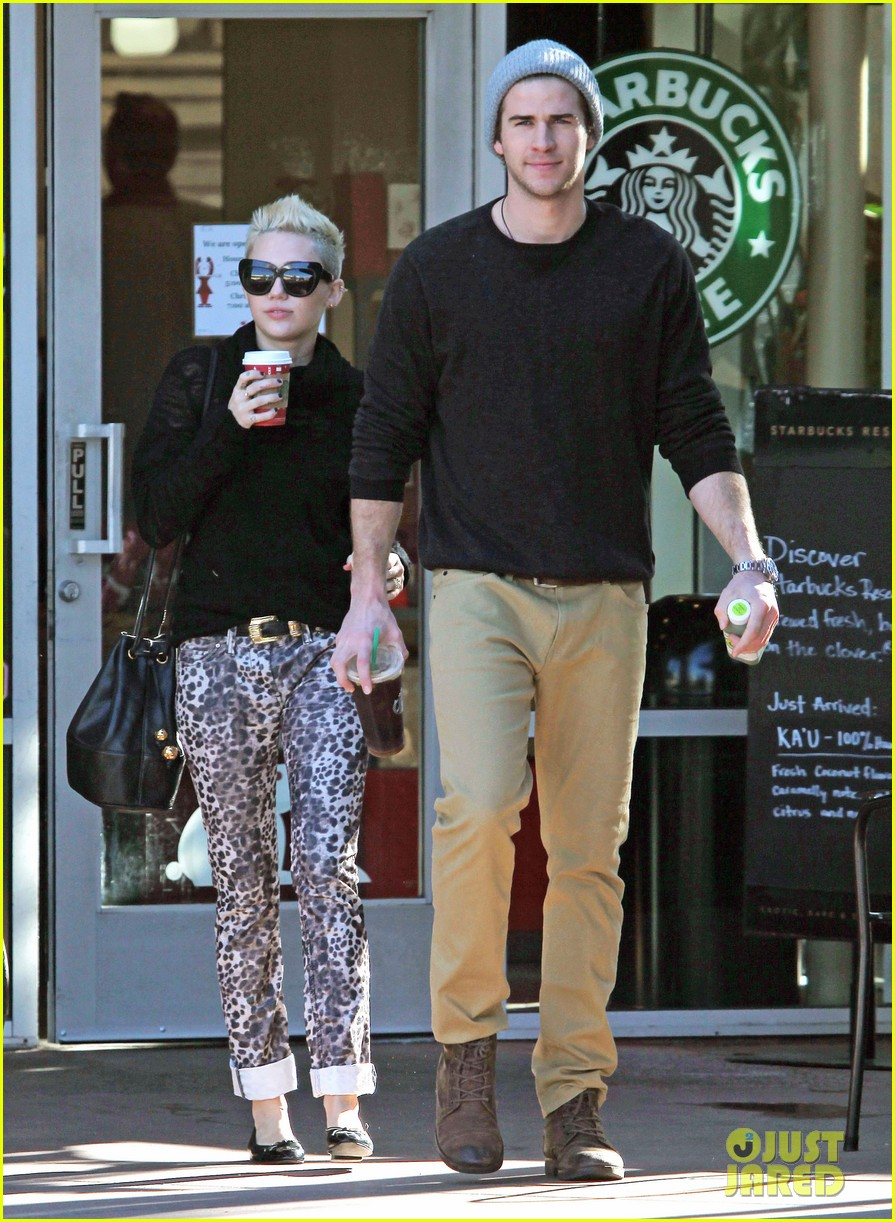 miley cyrus liam hemsworth holding hands at starbucks 032779795