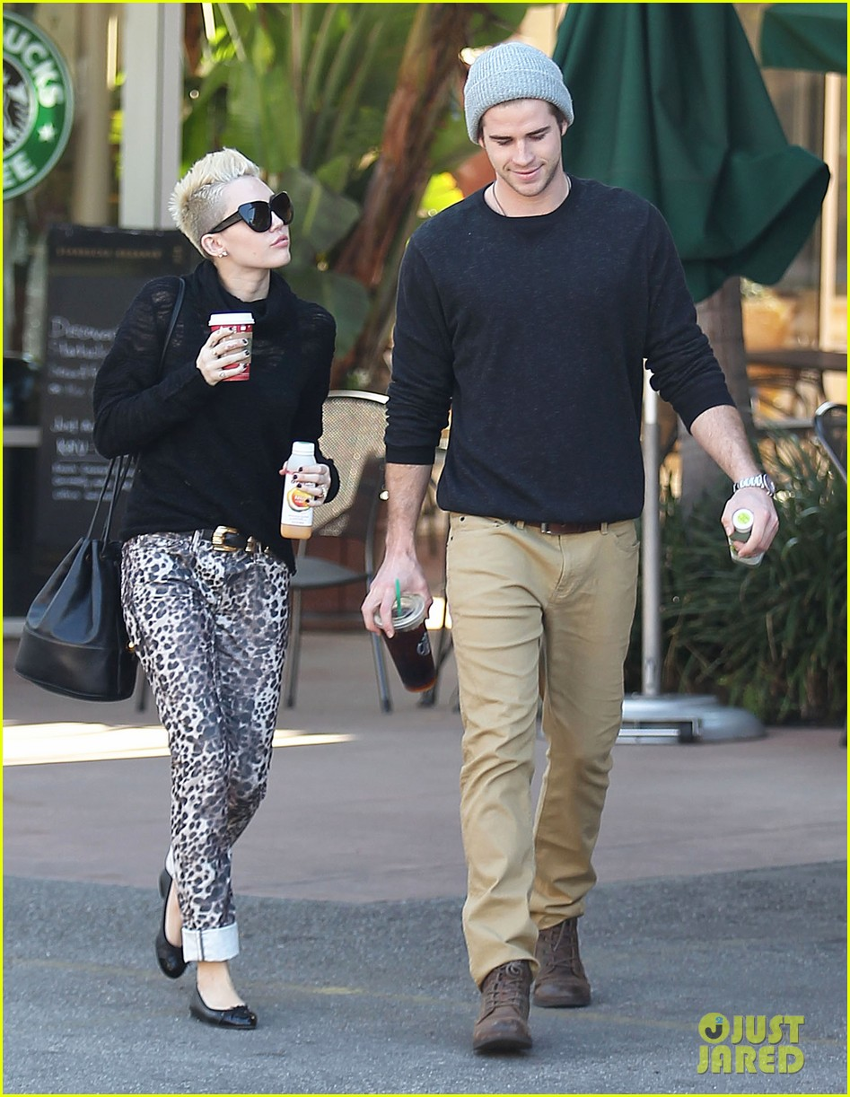 miley cyrus liam hemsworth holding hands at starbucks 112779803