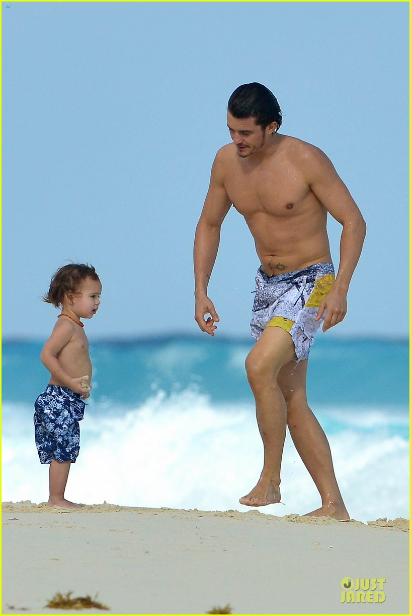 orlando bloom beach waves with flynn 152800887