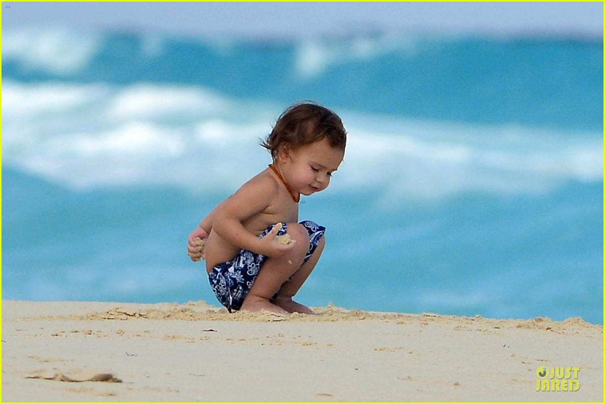 orlando bloom beach waves with flynn 242800896