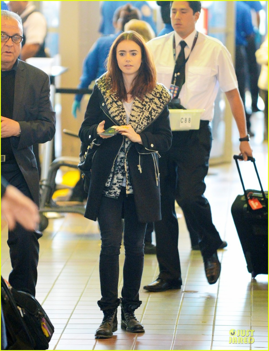 lily collins passport departure at lax airport 01