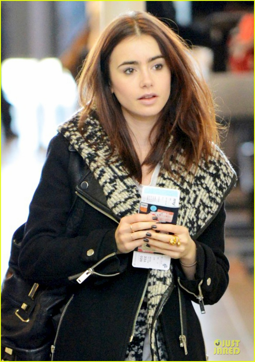 lily collins passport departure at lax airport 022801083
