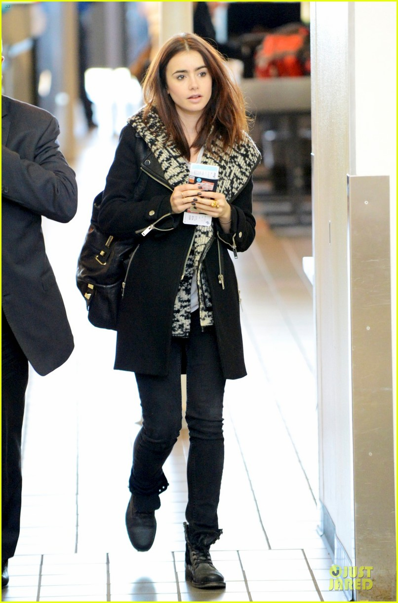 lily collins passport departure at lax airport 032801084