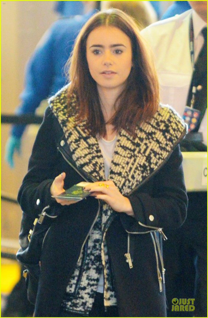 lily collins passport departure at lax airport 042801085