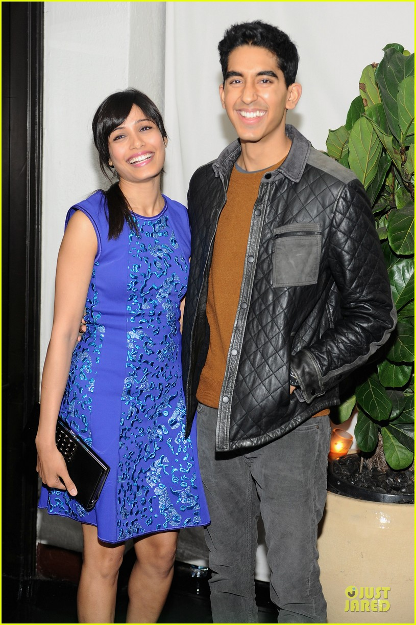 freida pinto dev patel w magazine pre golden globes party 02