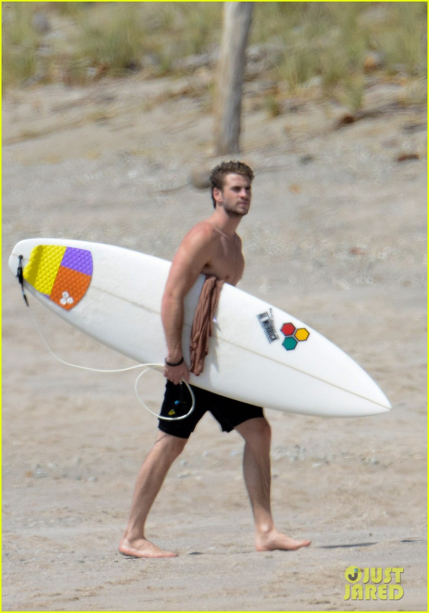 chris liam hemsworth shirtless surfing duo 01