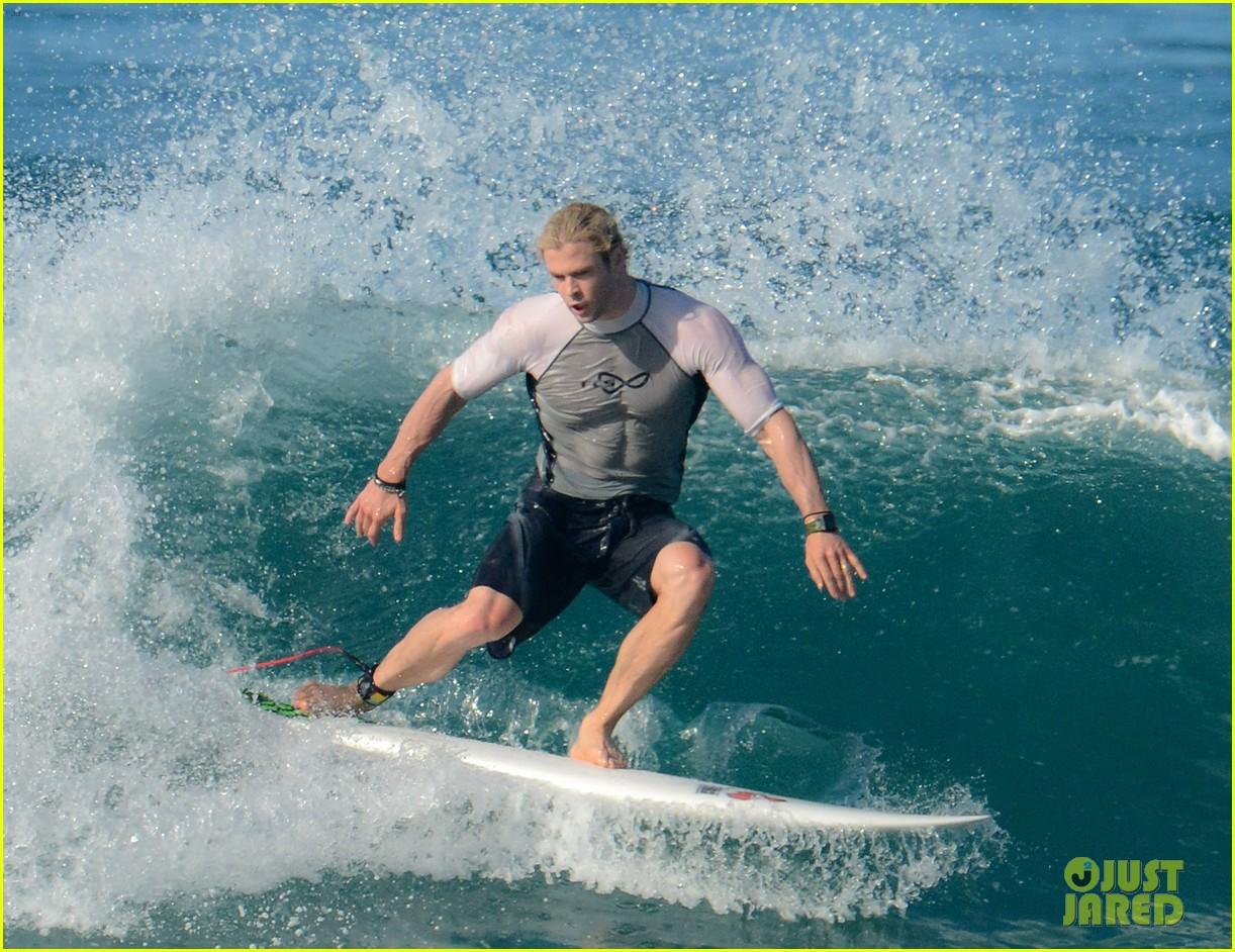 chris liam hemsworth shirtless surfing duo 022799379