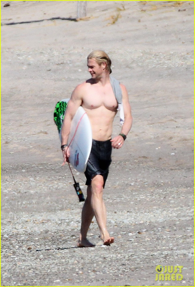 chris liam hemsworth shirtless surfing duo 032799380