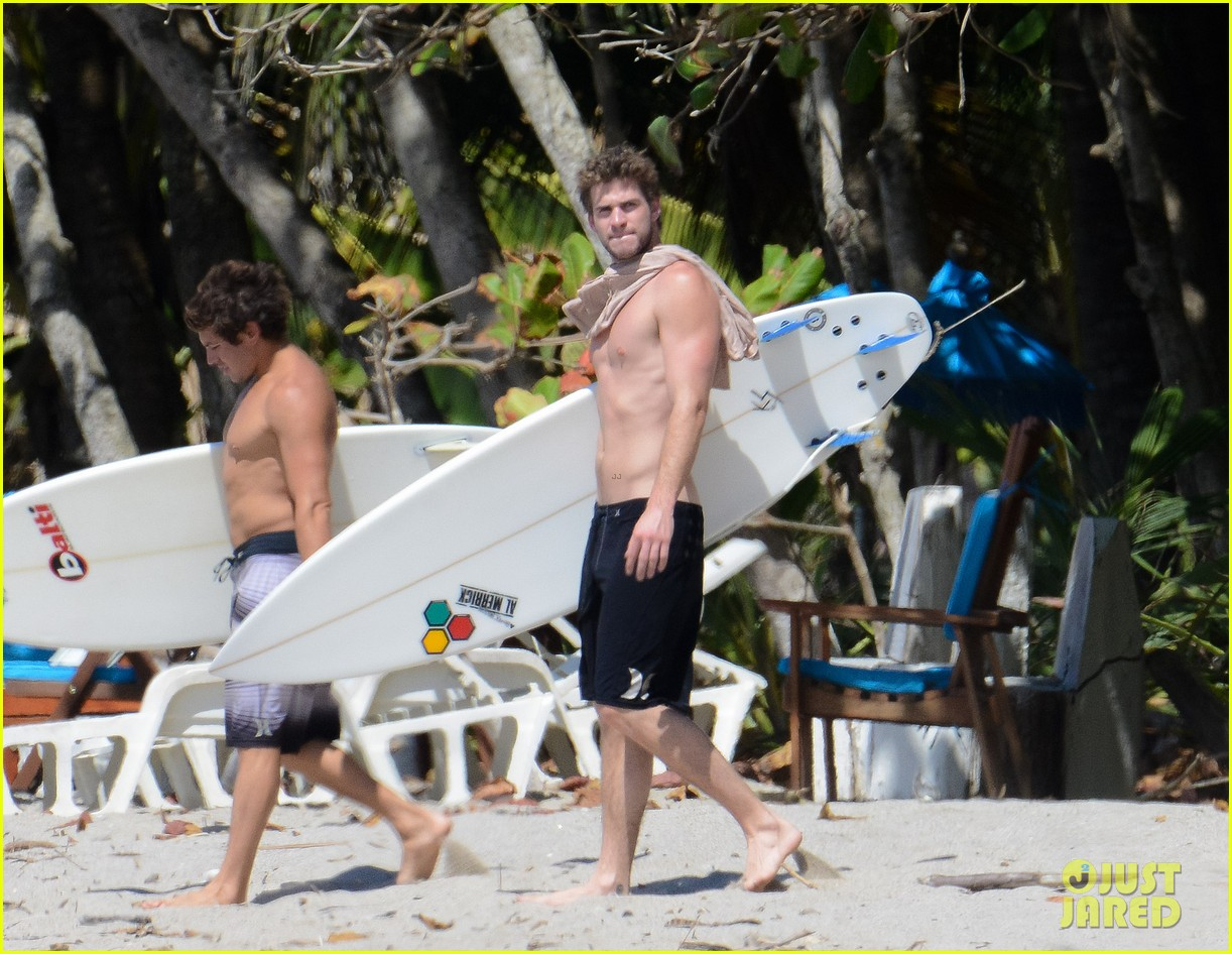 chris liam hemsworth shirtless surfing duo 062799383
