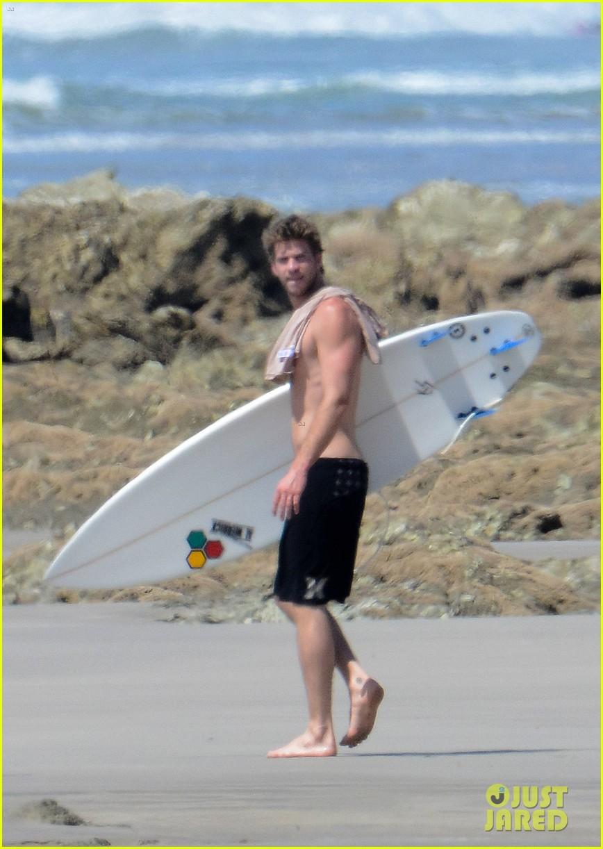 chris liam hemsworth shirtless surfing duo 102799387