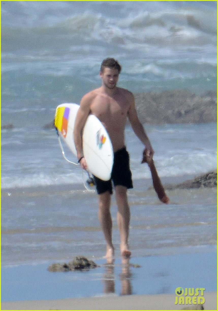 chris liam hemsworth shirtless surfing duo 122799389