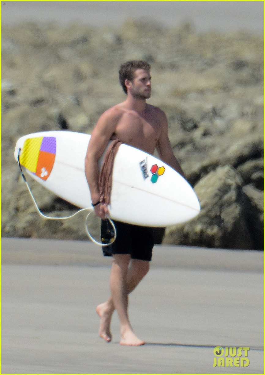 chris liam hemsworth shirtless surfing duo 162799393