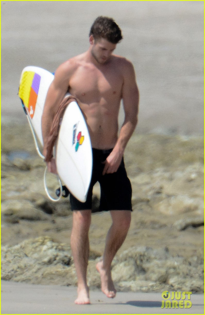 chris liam hemsworth shirtless surfing duo 172799394