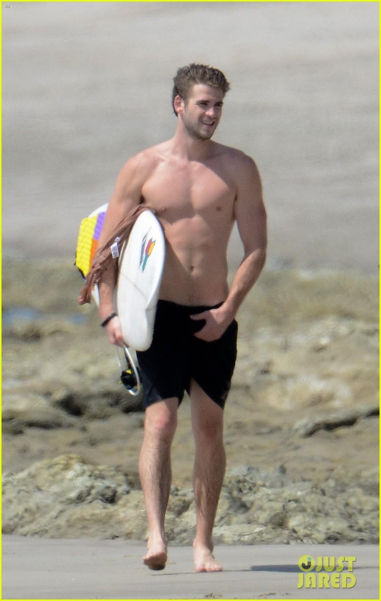 chris liam hemsworth shirtless surfing duo 182799395