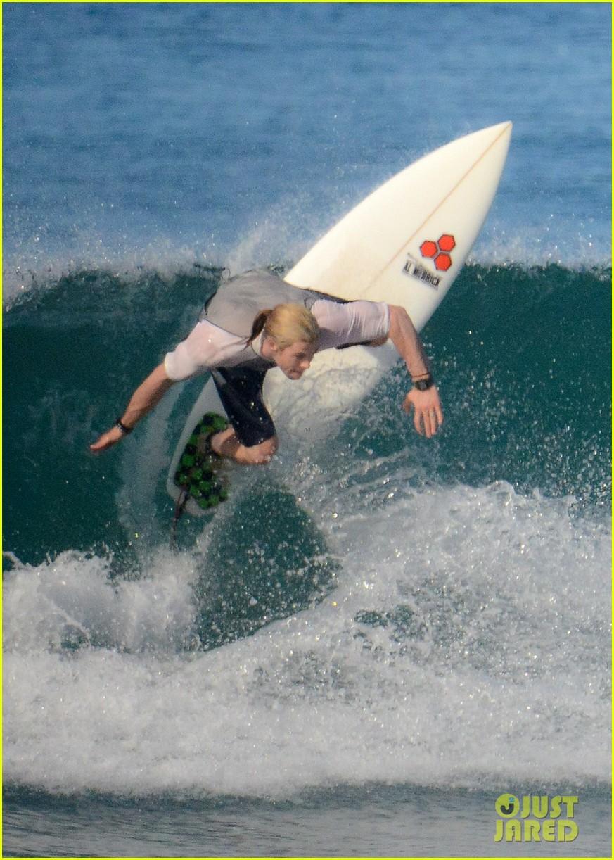 chris liam hemsworth shirtless surfing duo 252799402