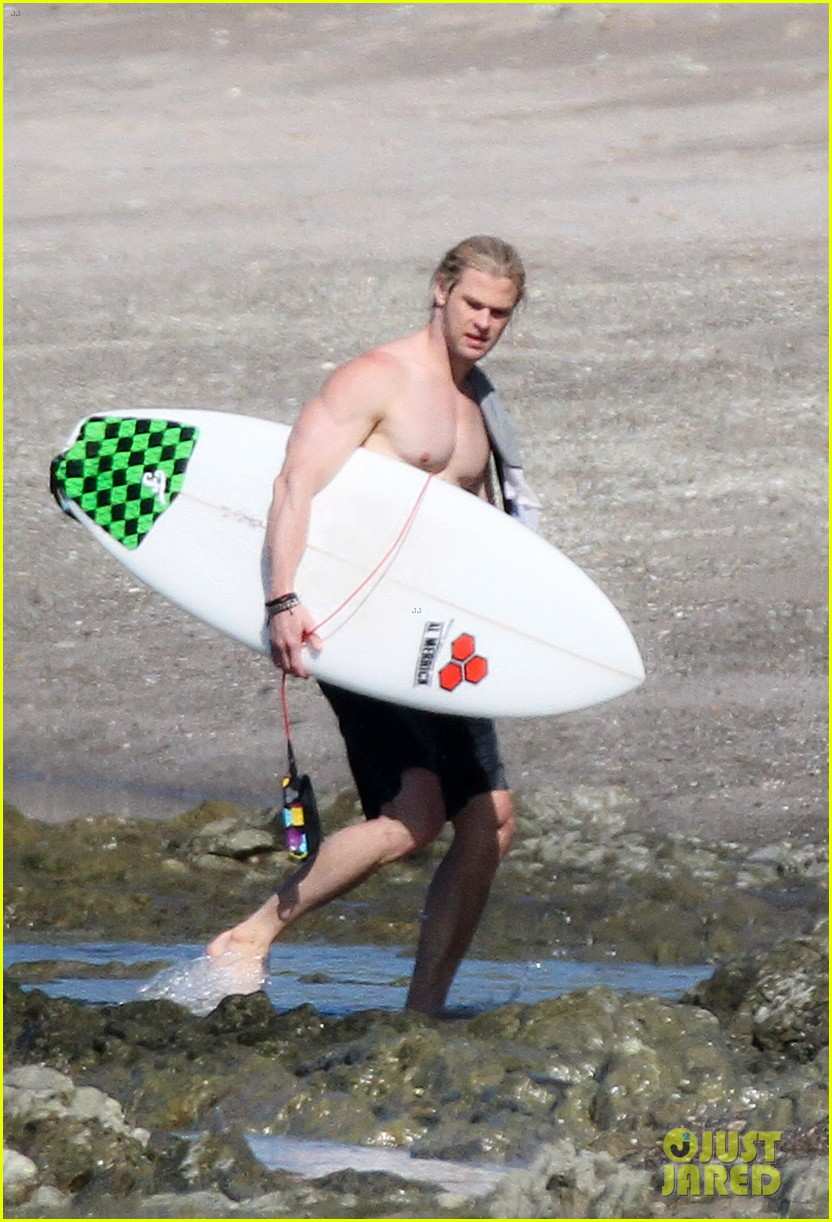 chris liam hemsworth shirtless surfing duo 332799410