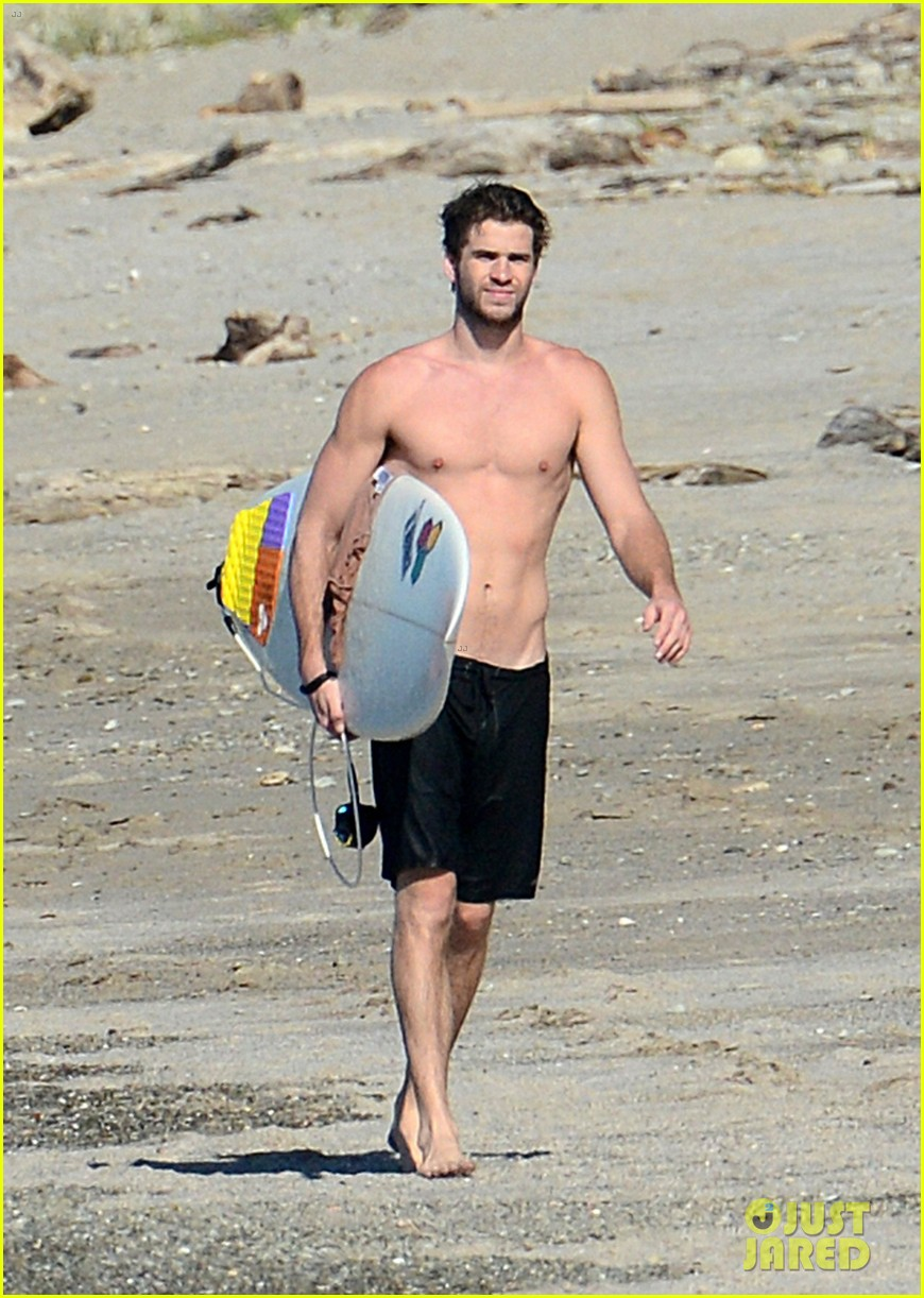 chris liam hemsworth shirtless surfing duo 352799412