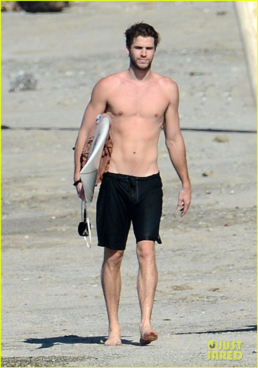 chris liam hemsworth shirtless surfing duo 372799414