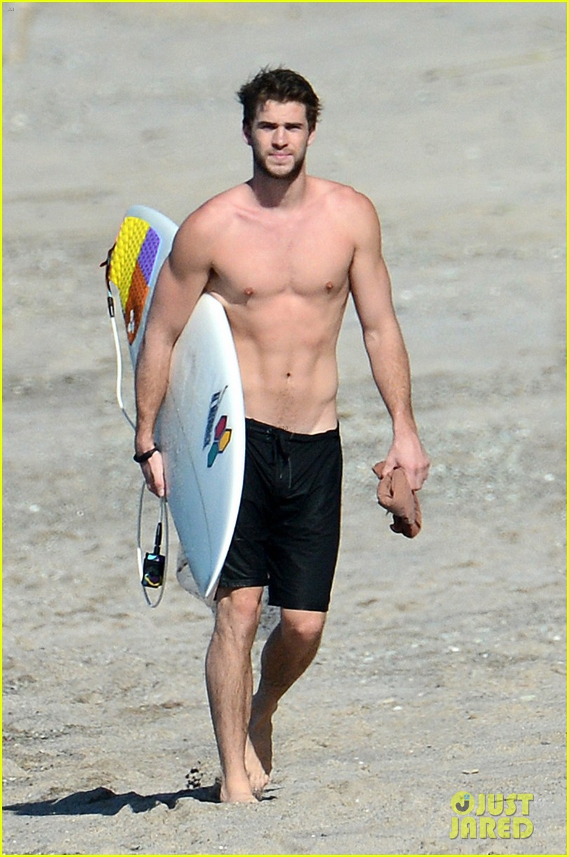 chris liam hemsworth shirtless surfing duo 382799415