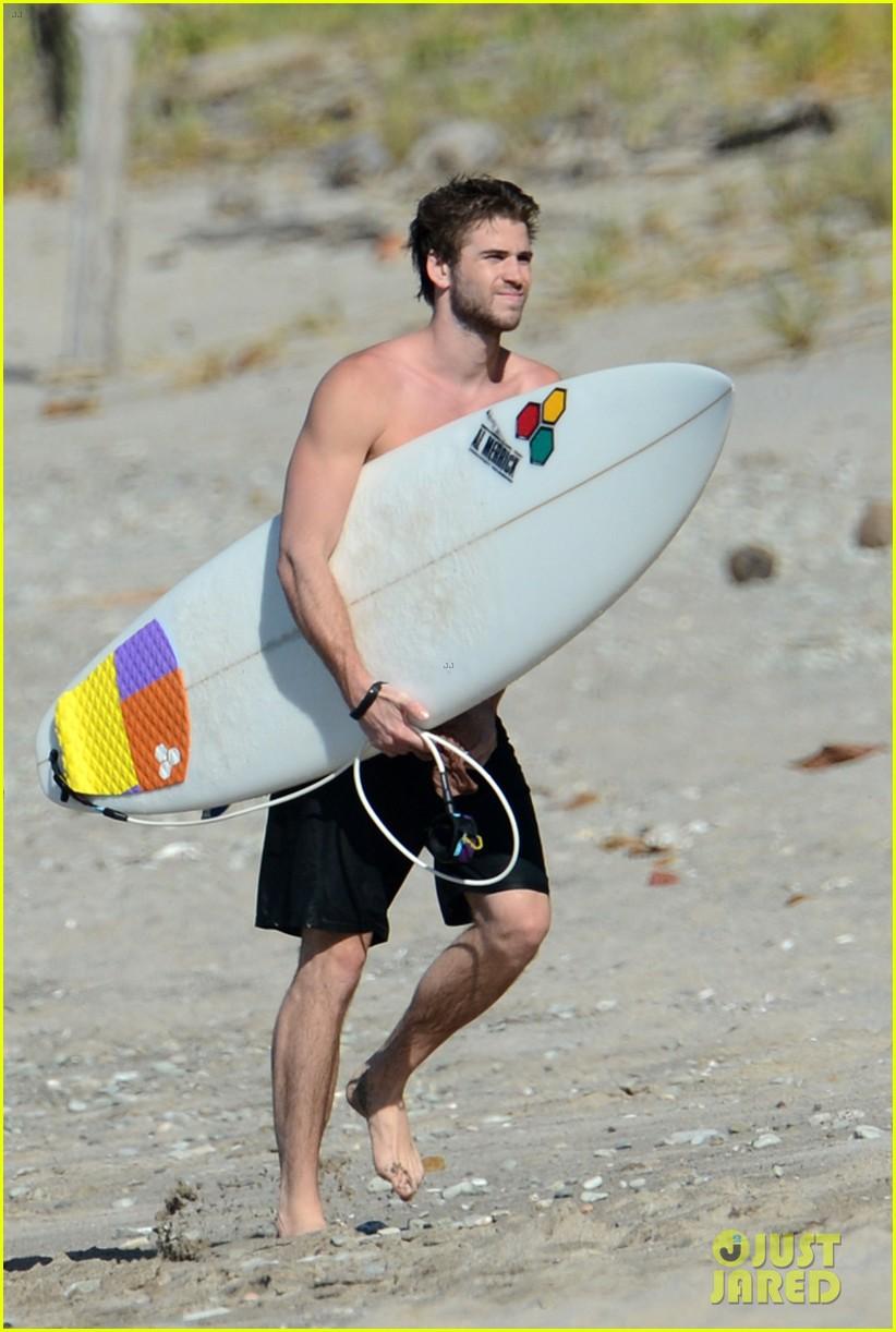 chris liam hemsworth shirtless surfing duo 402799417