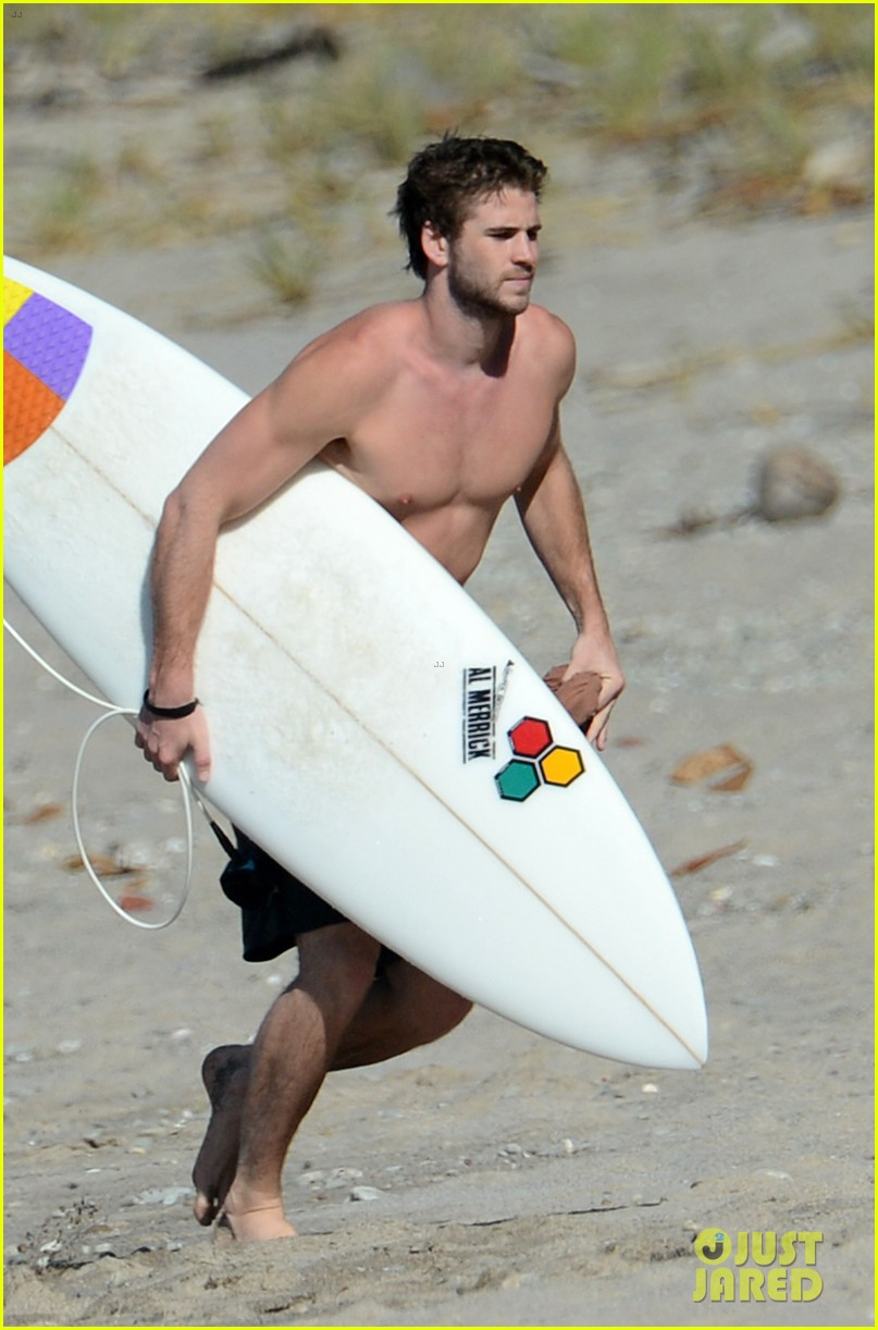 chris liam hemsworth shirtless surfing duo 422799419
