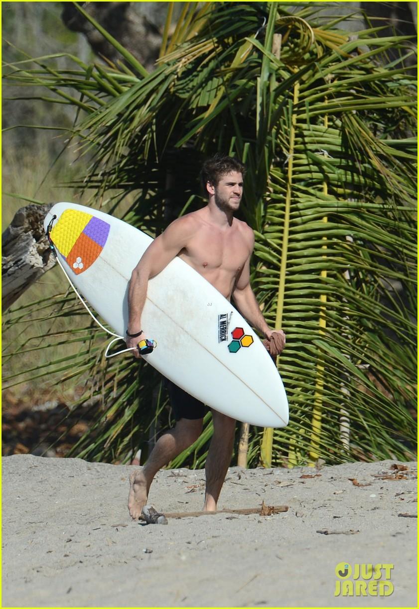 chris liam hemsworth shirtless surfing duo 452799422