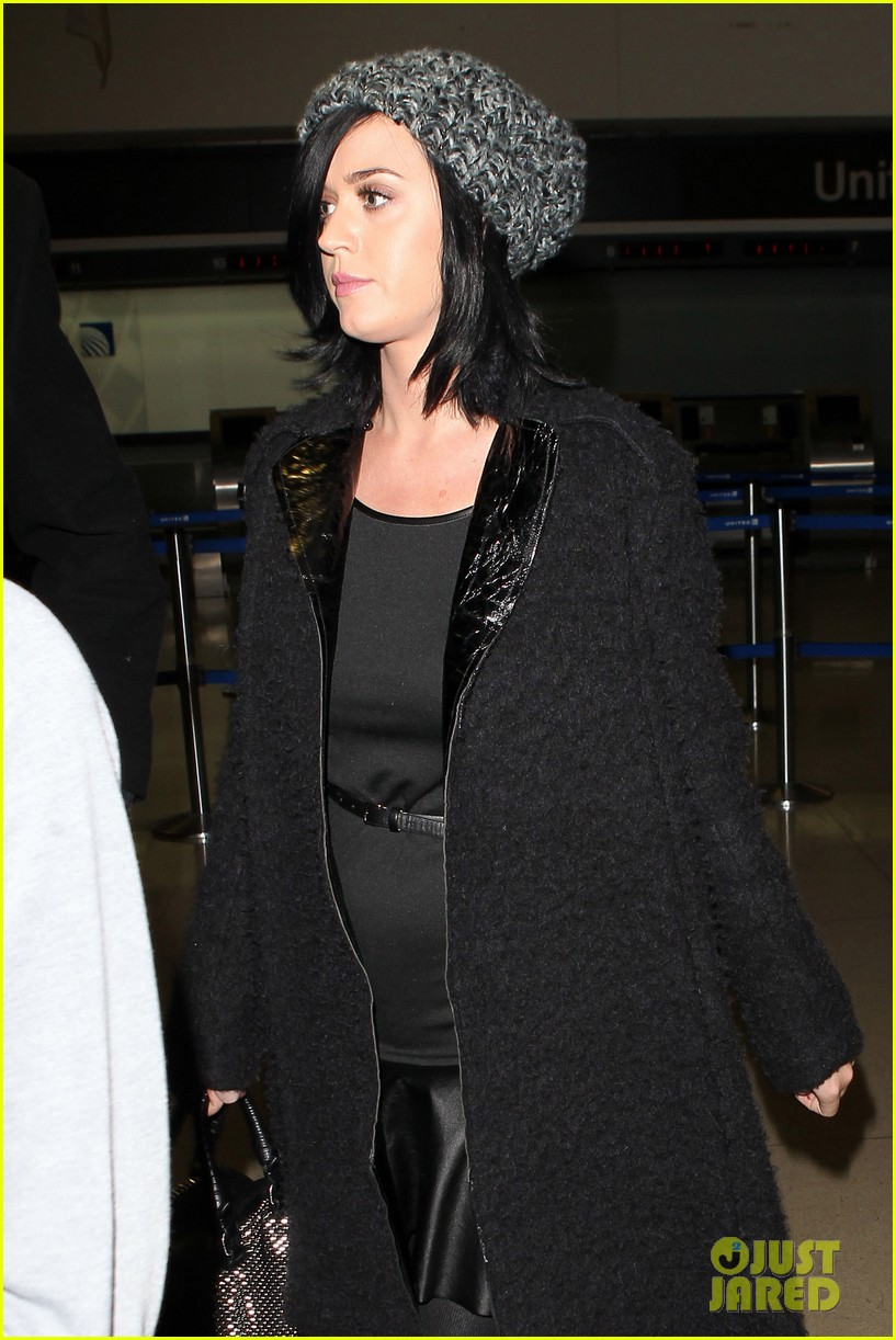katy perry eva longoria arrive at lax after inauguration 052797315