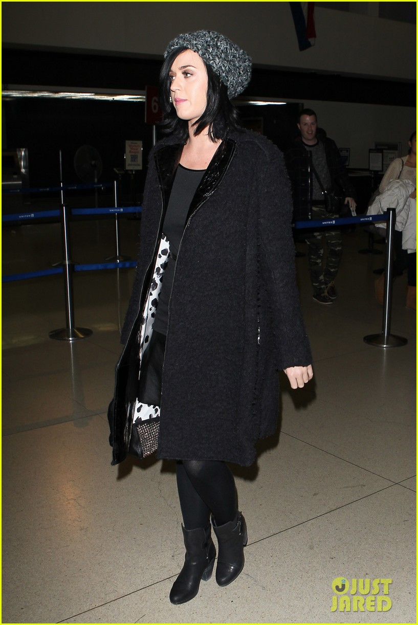 katy perry eva longoria arrive at lax after inauguration 092797319