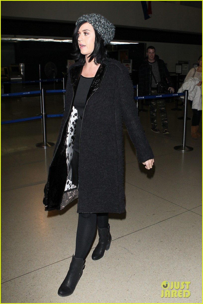 katy perry eva longoria arrive at lax after inauguration 10