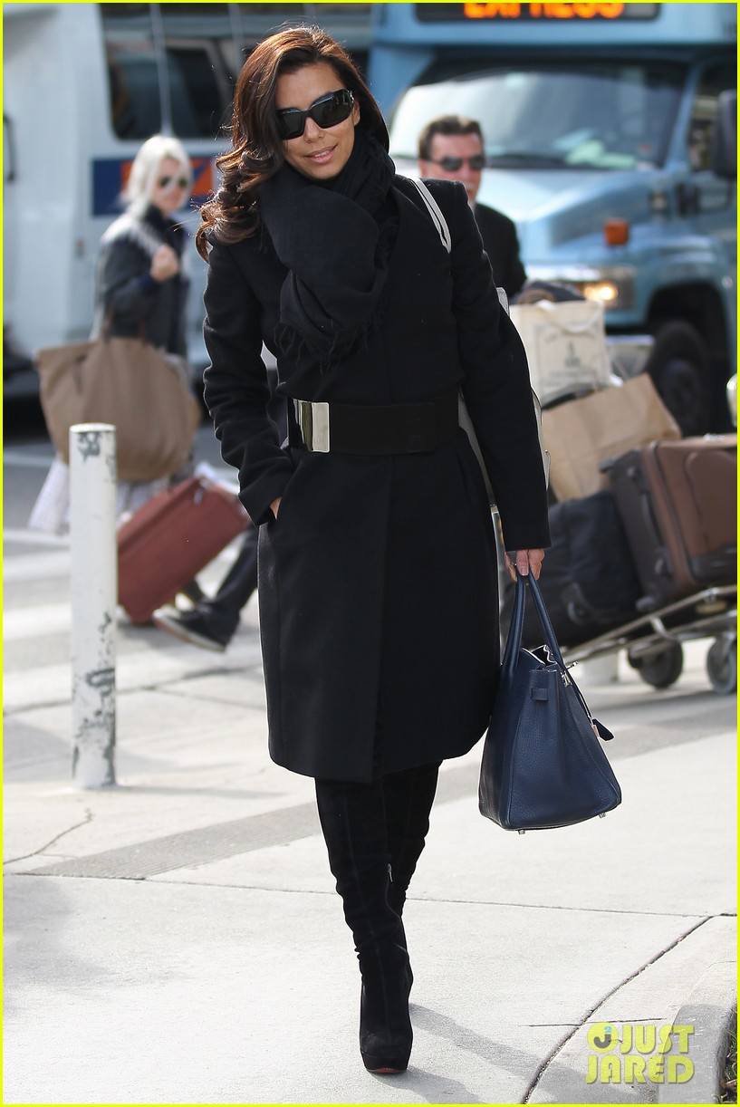 katy perry eva longoria arrive at lax after inauguration 14