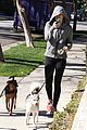 miley cyrus hoodie walk with pet pooch 10