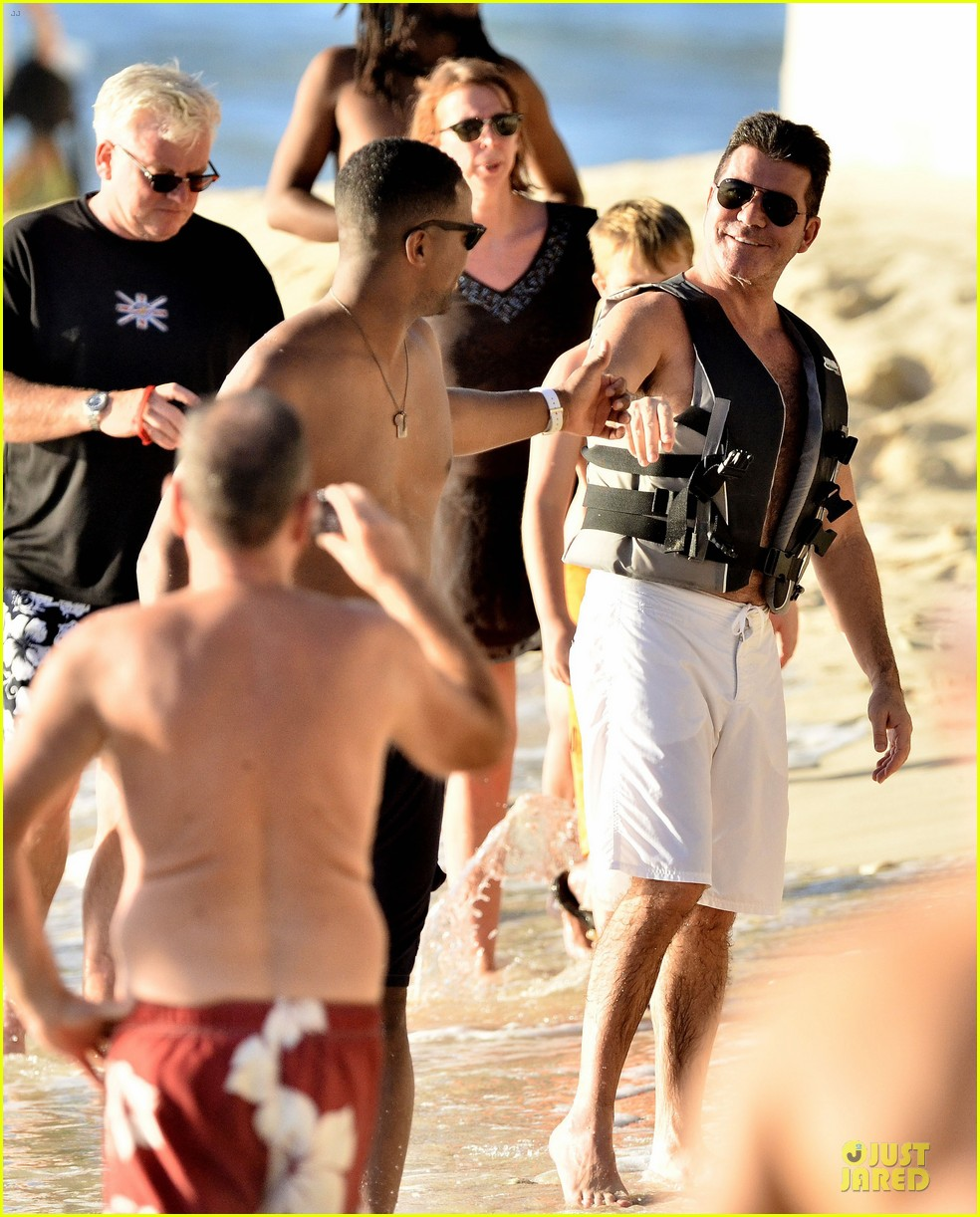 simon cowell shirtless new years eve with mezhgan huissany 202783301
