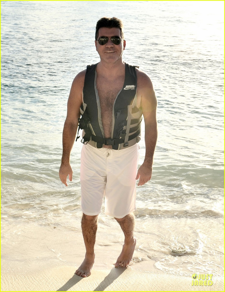simon cowell shirtless new years eve with mezhgan huissany 232783304