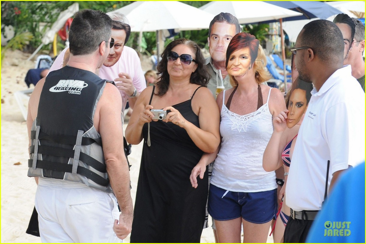 simon cowell shirtless new years eve with mezhgan huissany 292783310
