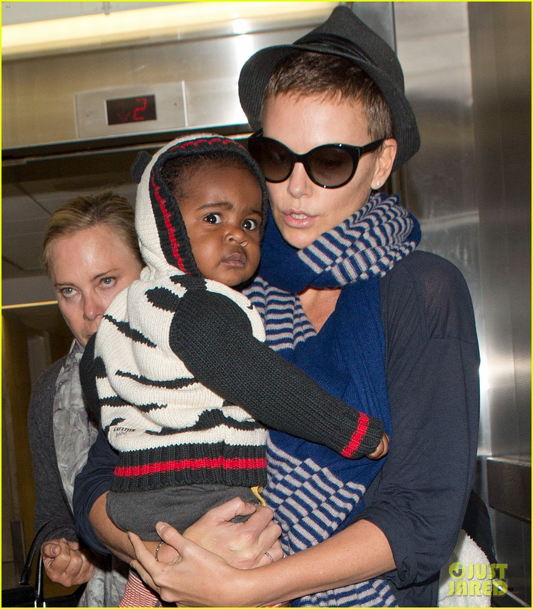 charlize theron lax arrival with jackson 042786102