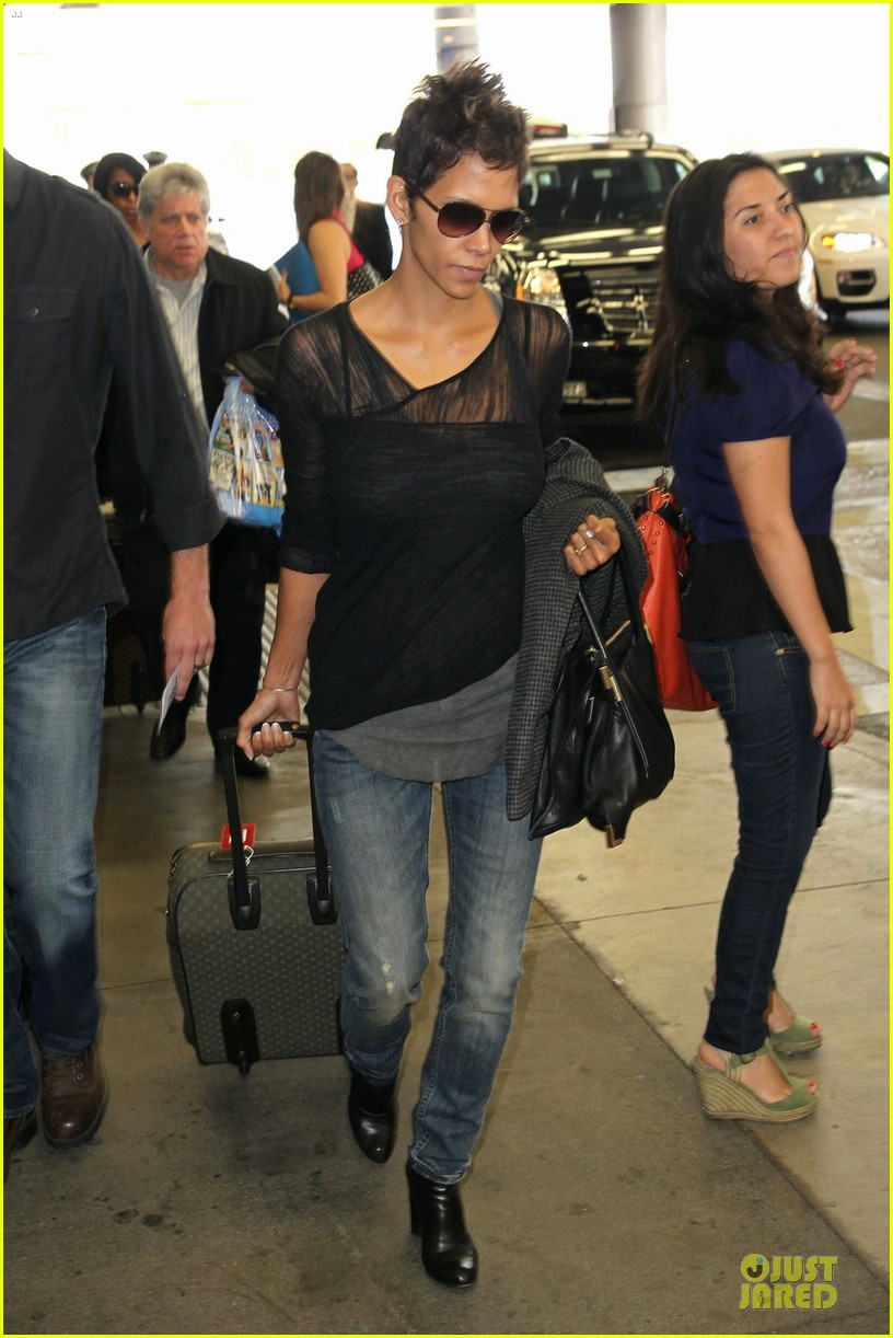 halle berry olivier martinez different airport arrivals 062821471