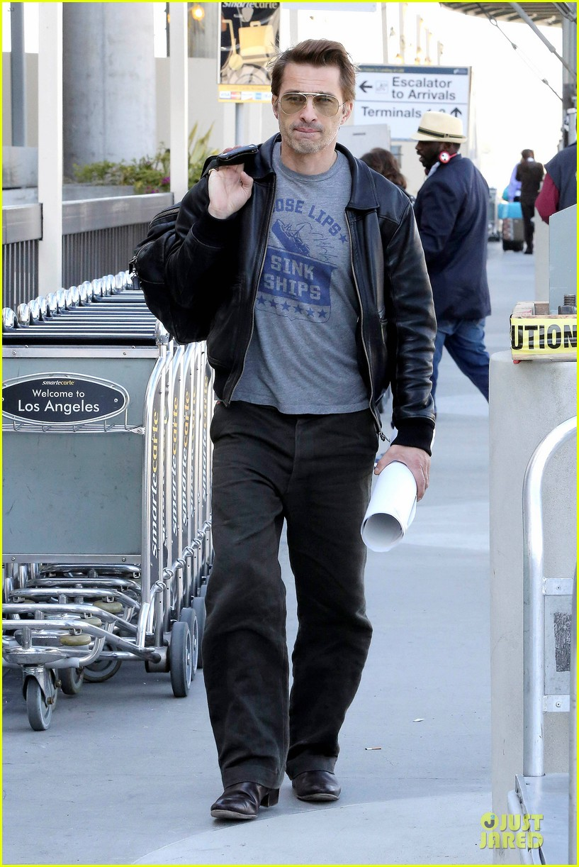 halle berry olivier martinez different airport arrivals 082821473