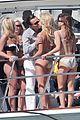 leonardo dicarprio kisses swimsuit clad girl for video shoot 06