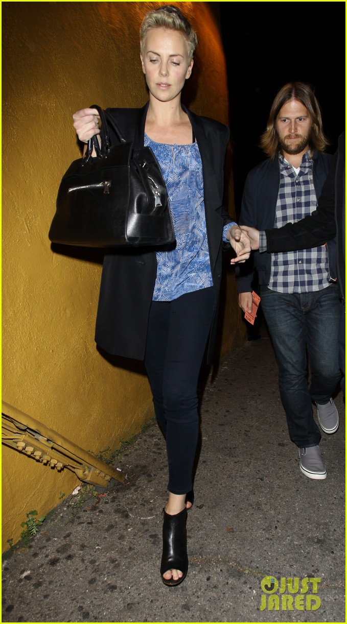 charlize theron partners with toms shoes to prevent aids 032821663
