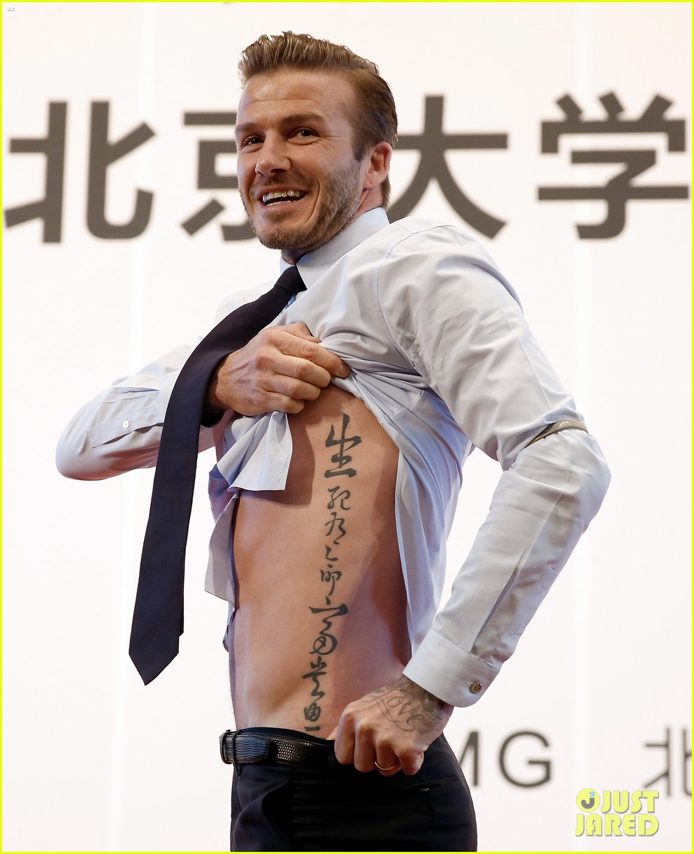 david beckham flashes shirtless body at university visit 022836833