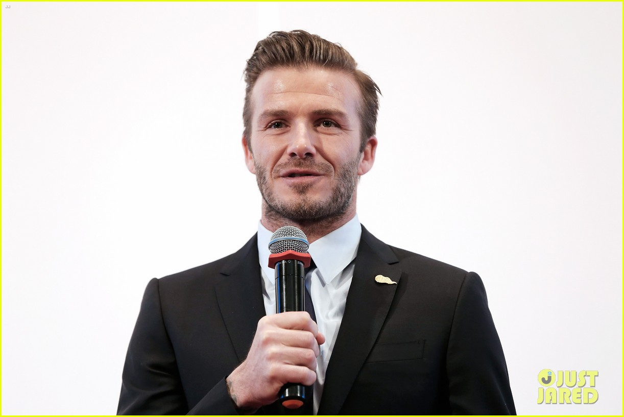 david beckham flashes shirtless body at university visit 22