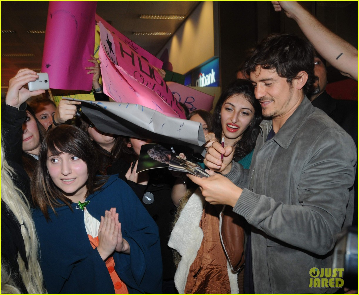 orlando bloom greeted by fans at airport in istanbul 052834657