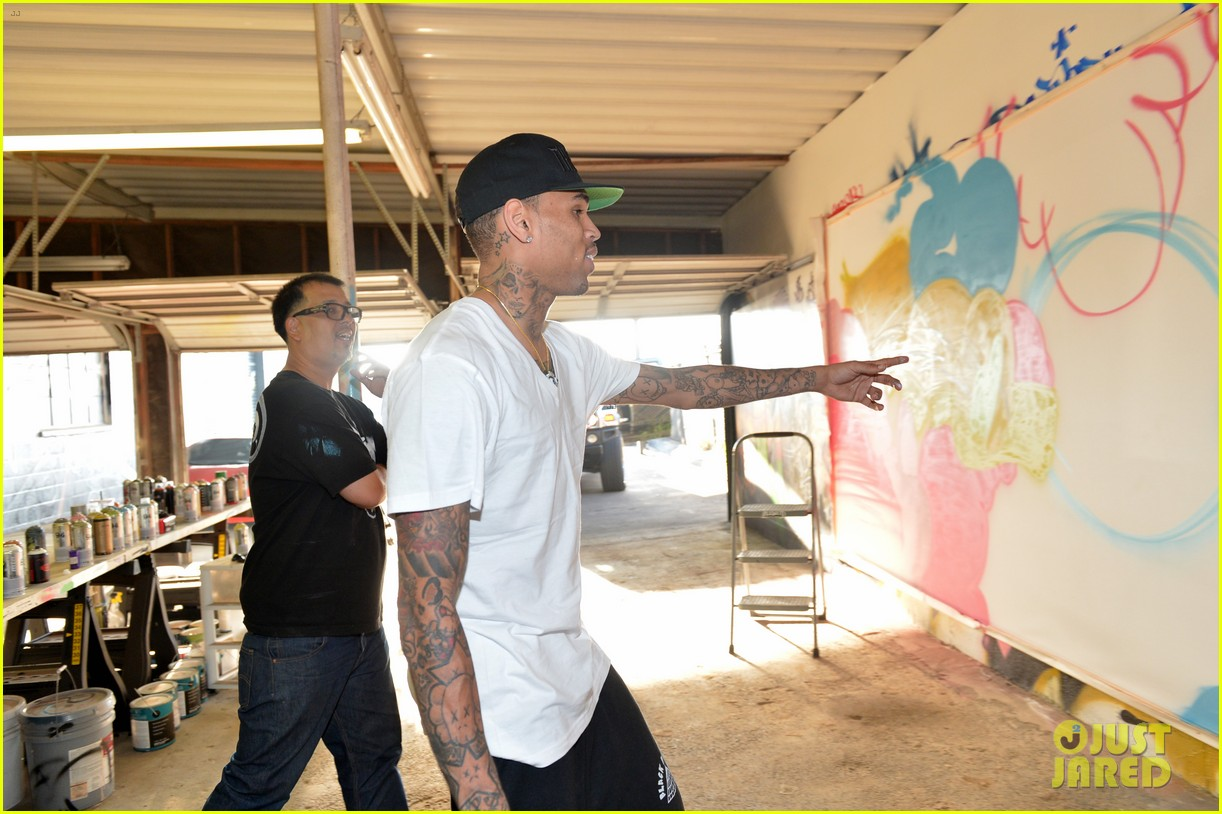 chris brown creates graffiti artwork for charity 232832873
