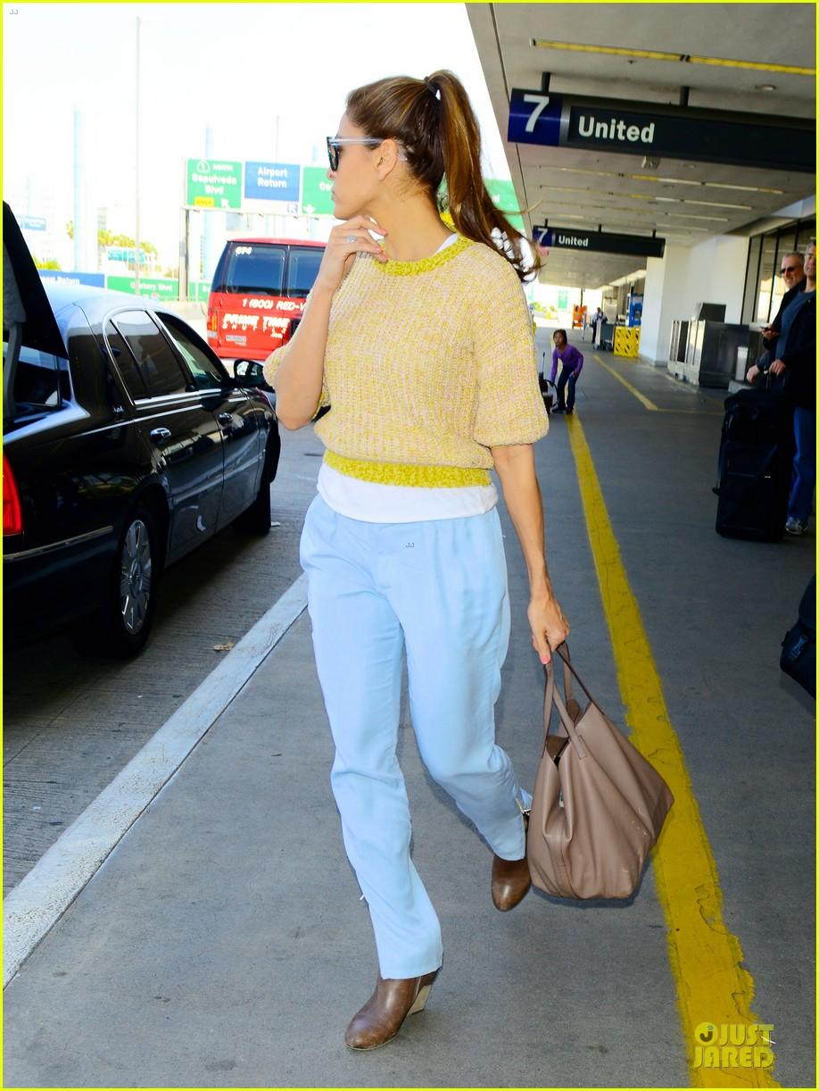 ryan gosling eva mendes separate lax airport arrivals 052835865