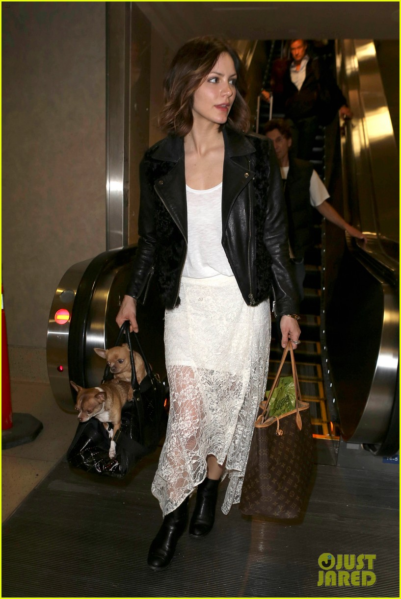 katharine mcphee double puppy purse at airport 092831780
