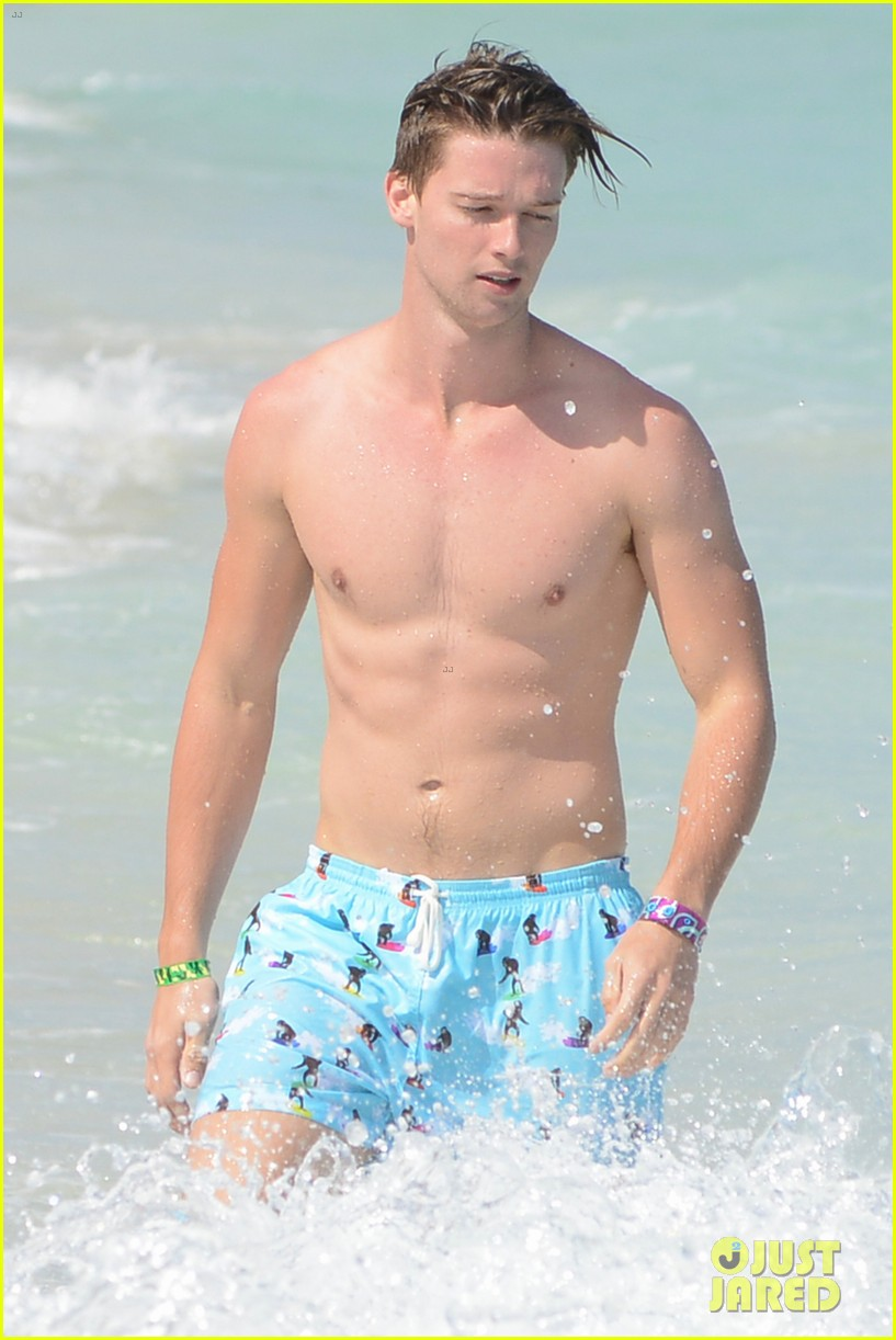patrick schwarzenegger shirtless beach football 102837560