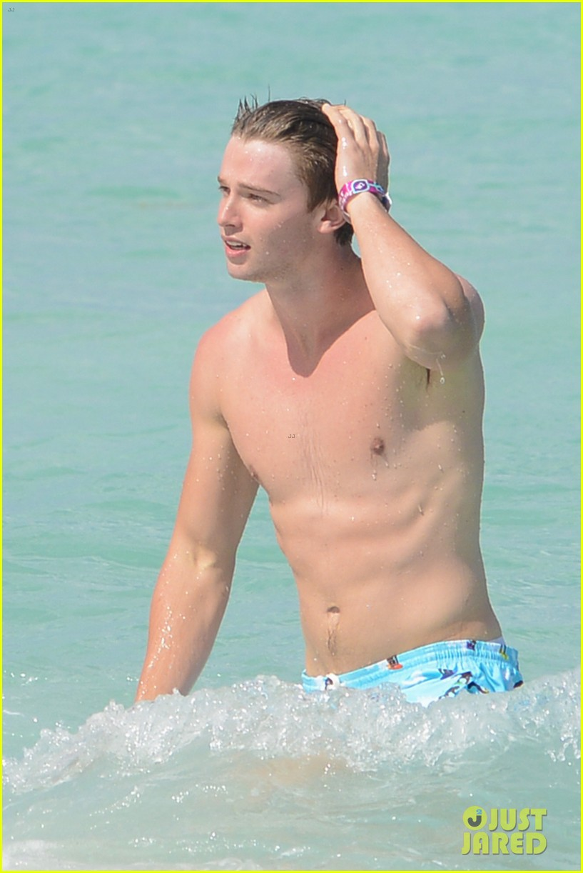 patrick schwarzenegger shirtless beach football 142837564