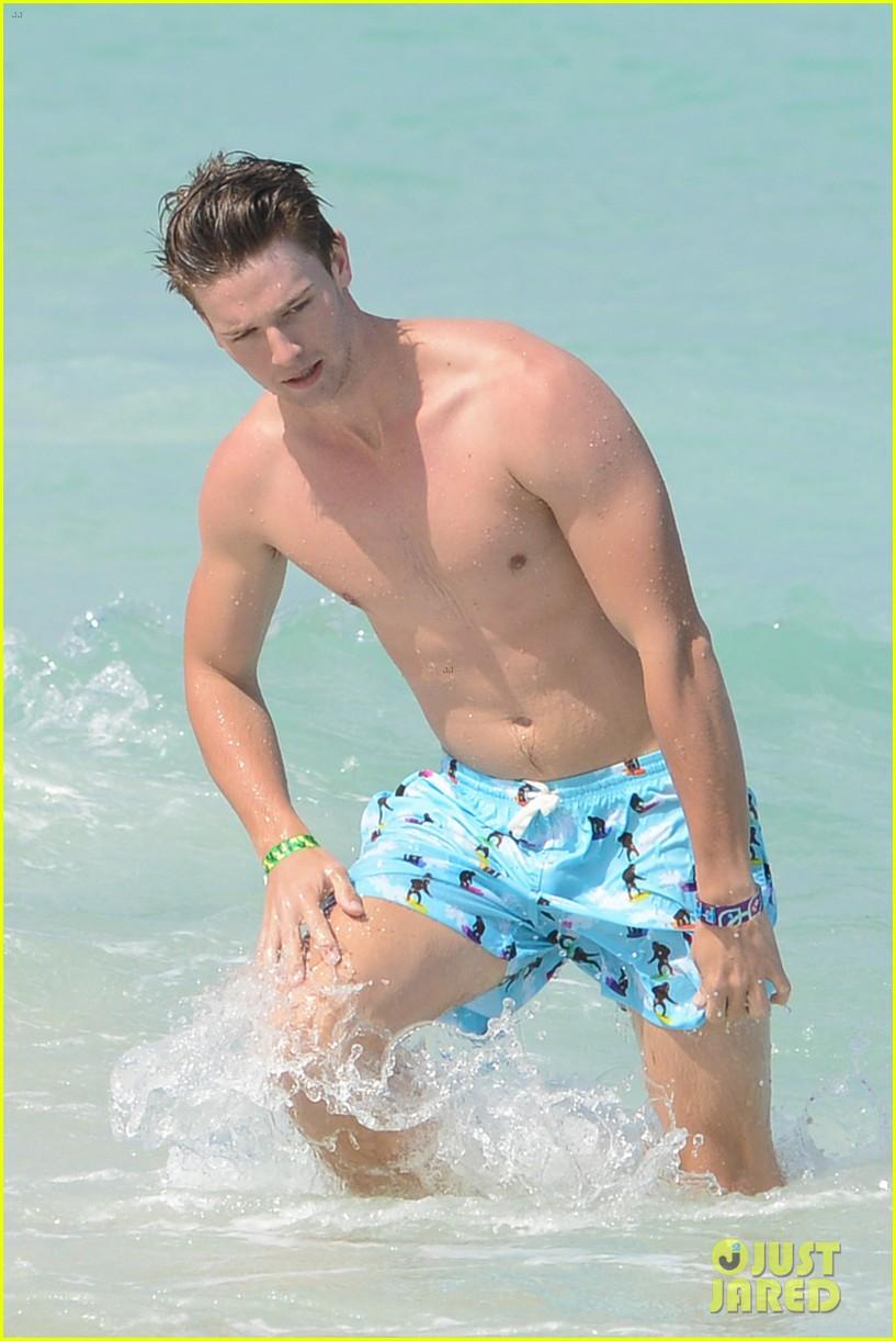 patrick schwarzenegger shirtless beach football 182837568